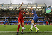 Liverpool midfielder Jordan Henderson (14) battles with Chelsea defender Marcos Alonso (3)  during the Premier League match between Chelsea and Liverpool at Stamford Bridge, London, England on 22 September 2019.