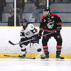 TORONTO, ON  - APR 10,  2018: Ontario Junior Hockey League, South West Conference Championship Series. Game seven of the best of seven series between Georgetown Raiders and the Toronto Patriots. Nicolas Aromatario #4 of the Toronto Patriots battles for control with Andrew Cordssen-David #7 of the Georgetown Raiders during the first period.<br /> (Photo by Andy Corneau / OJHL Images)