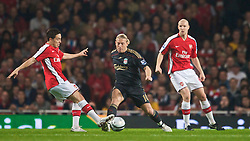 LONDON, ENGLAND - Wednesday, October 28, 2009: Liverpool's Andriy Voronin and Arsenal's Samir Nasri during the League Cup 4th Round match at Emirates Stadium. (Photo by David Rawcliffe/Propaganda)