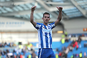Brighton & Hove Albion central defender Uwe Huenemeier (4) celebrates at the final whistle during the EFL Sky Bet Championship match between Brighton and Hove Albion and Blackburn Rovers at the American Express Community Stadium, Brighton and Hove, England on 1 April 2017.