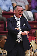 November 14, 2014; Stanford, CA, USA; Wofford Terriers head coach Mike Young smiles during the first half against the Stanford Cardinal at Maples Pavilion.