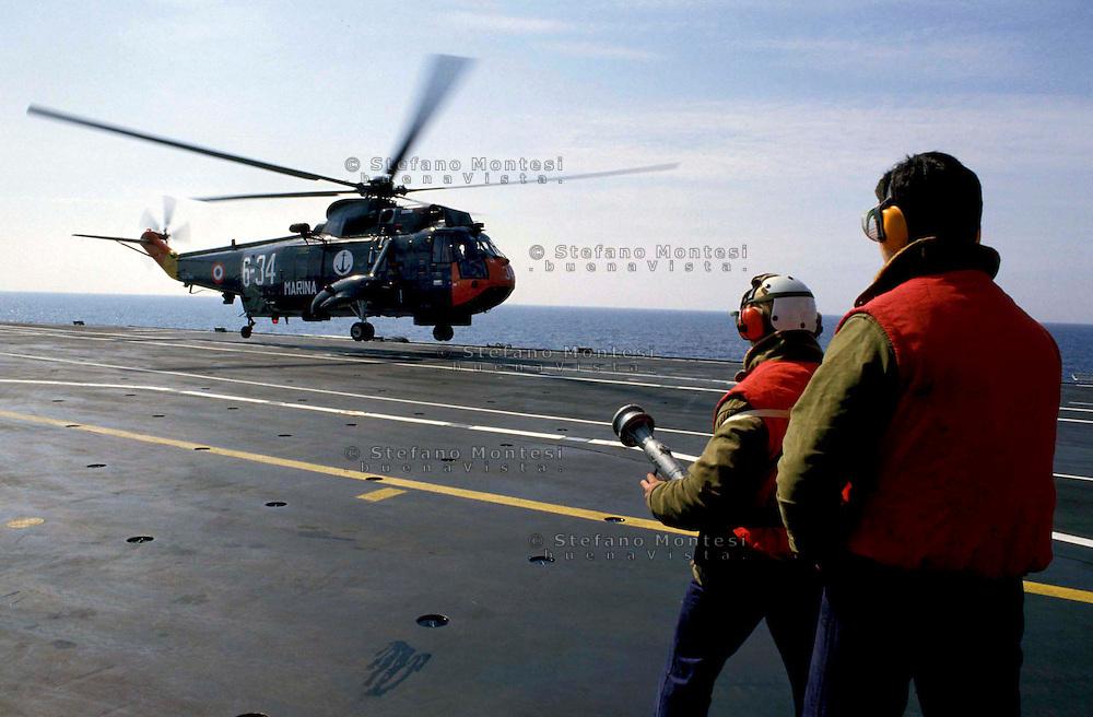 "The Italian aircraft carrier  ""G. Garibaldi""..Antisubmarine helicopters SH-3D ..Fireproof service on bridge of flight"