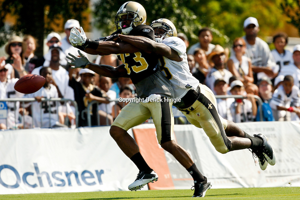 July 31, 2010; Metairie, LA, USA; New Orleans Saints wide receiver Rod Harper (13) grabs cornerback Jabari Greer (33) from behind on a deep pass during a training camp practice at the New Orleans Saints practice facility. Mandatory Credit: Derick E. Hingle