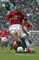 Photo. Andrew Unwin.<br /> Manchester United v Southampton, Barclaycard Premier League, Old Trafford, Manchester 31/01/2004.<br /> Manchester United's Mikael Silvestre (l) is challenged by Southampton's James Beattie (r).