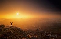 Hiker at sunrise in the Badlands, Dinosaur Provincial Park World Heritage Site, Alberta, Canada