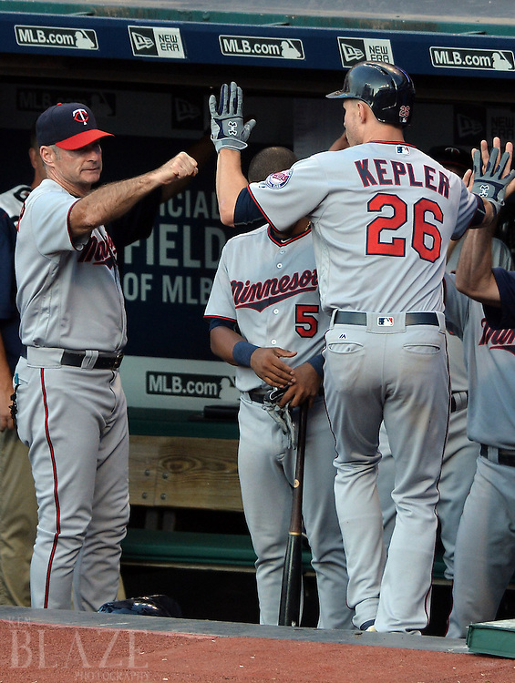 Aug 2, 2016; Cleveland, OH, USA; Minnesota Twins right fielder Max Kepler (26) celebrates after after hitting a home run with manager Paul Molitor (4) during the third inning against the Cleveland Indians at Progressive Field. Mandatory Credit: Ken Blaze-USA TODAY Sports