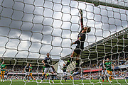 Preston North End goalkeeper Declan Rudd (1) tips the ball over the bar during the EFL Sky Bet Championship match between Millwall and Preston North End at The Den, London, England on 3 August 2019.
