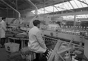 21/5/1965<br /> 5/21/1965<br /> 21/5/1965<br /> <br /> A Quality Control Officer inspects the bottles for flaws before they head to the filler