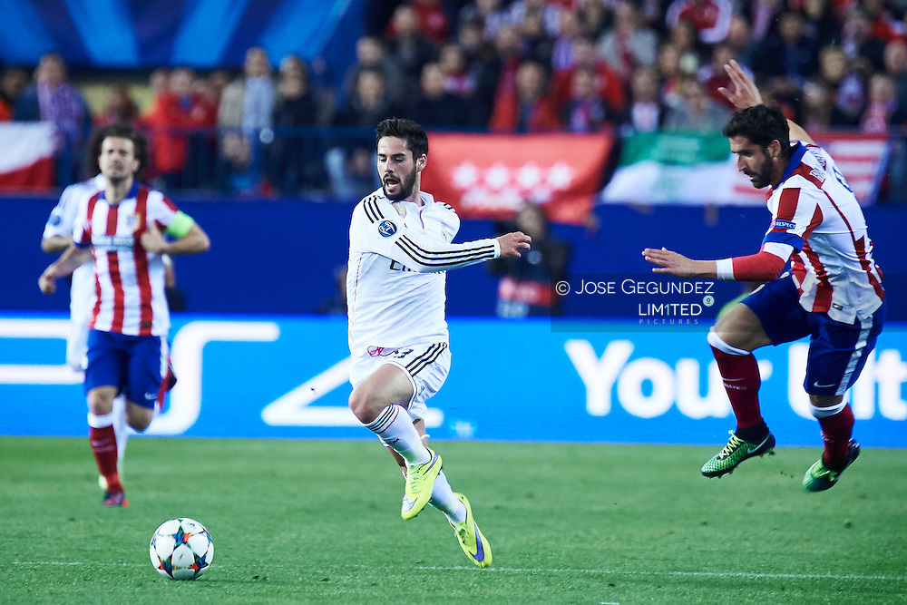 Isco (Real Madrid F.C.) and Raul Garcia in action during the Champions League, round of 4 match between Atletico de Madrid and Real Madrid at Estadio Vicente Calderon on April 14, 2015 in Madrid, Spain