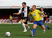Photo: Paul Thomas.<br /> Grimsby Town v Hereford United. Coca Cola League 2. 08/10/2006.<br /> <br /> John McDermott (L) of Grimsby keeps the ball away from Simon Travis.