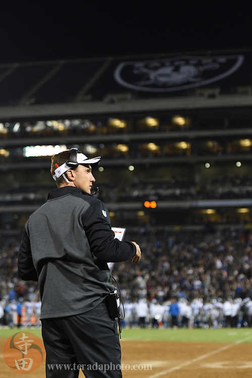August 15, 2014; Oakland, CA, USA; Oakland Raiders head coach Dennis Allen watches from the sideline during the fourth quarter against the Detroit Lions at O.co Coliseum.