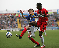 Photo: Lee Earle.<br /> Portsmouth v Middlesbrough. The Barclays Premiership. 15/04/2006. Pompey's Andres D'Alessandro (L) clashes with George Boateng.