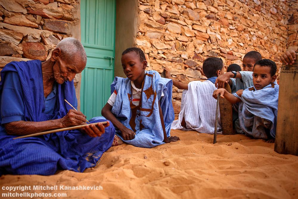 Mauritanian children learning the quaran in an Islamic school called a mahadara. Adrar, Mauritania