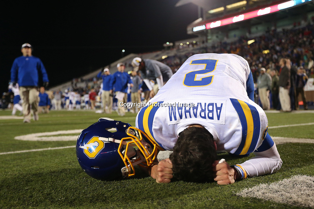 Lauren Wood | Buy at photos.djournal.com<br /> Oxford quarterback Jack Abraham hangs his head after Oxford fell to Wayne County 45-41 in the 5A state championship game Saturday night in Oxford.