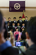 School girls wearing traditional kimono take part in their elementary school graduation in Japan. Tsukushino Elementary School, machida, Tokyo, Japan. Thursday March 22nd 2018