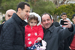 Syrian president Bashar Al Assad (left) and his wife Asma visit the Sednaya convent, and meet with children and religious personalities on Christmas day, in Sednaya, near Damascus, Syria on December 25, 2016. Photo by Balkis Press/ABACAPRESS.COM