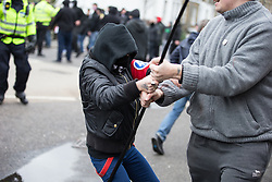 © Licensed to London News Pictures . 30/01/2016 . Dover , UK . Protesters fight at the demonstration . Demonstrations by far-right groups (including The National Front , The North West Infidels and The South East Alliance ) and , opposing them , anti-fascists , close to the port of Dover in Kent . Photo credit : Joel Goodman/LNP