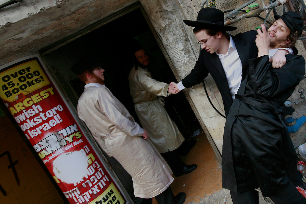 Ultra-Orthodox celebrate the Jewish holiday of Purim in the Mea Shearim neighbourhood of Jerusalem, Wednesday, March 11, 2009. The festival of Purim commemorates the rescue of Jews from genocide in ancient Persia. Many revelers will often consume alcohol to intoxication. Photo by Olivier Fitoussi /FLASH90