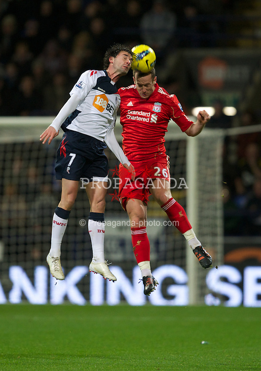 BOLTON, ENGLAND - Saturday, January 21, 2011: Liverpool's Charlie Adam in action against Bolton Wanderers' Chris Eagles during the Premiership match at the Reebok Stadium. (Pic by David Rawcliffe/Propaganda)
