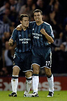 Photo: Glyn Thomas.<br />West Bromwich Albion. Newcastle Utd. The Barclays Premiership. 30/10/2005.<br /> Newcastle's Steven Taylor (R) and Scott Parker celebrate Michael Owen's goal early in the second half.