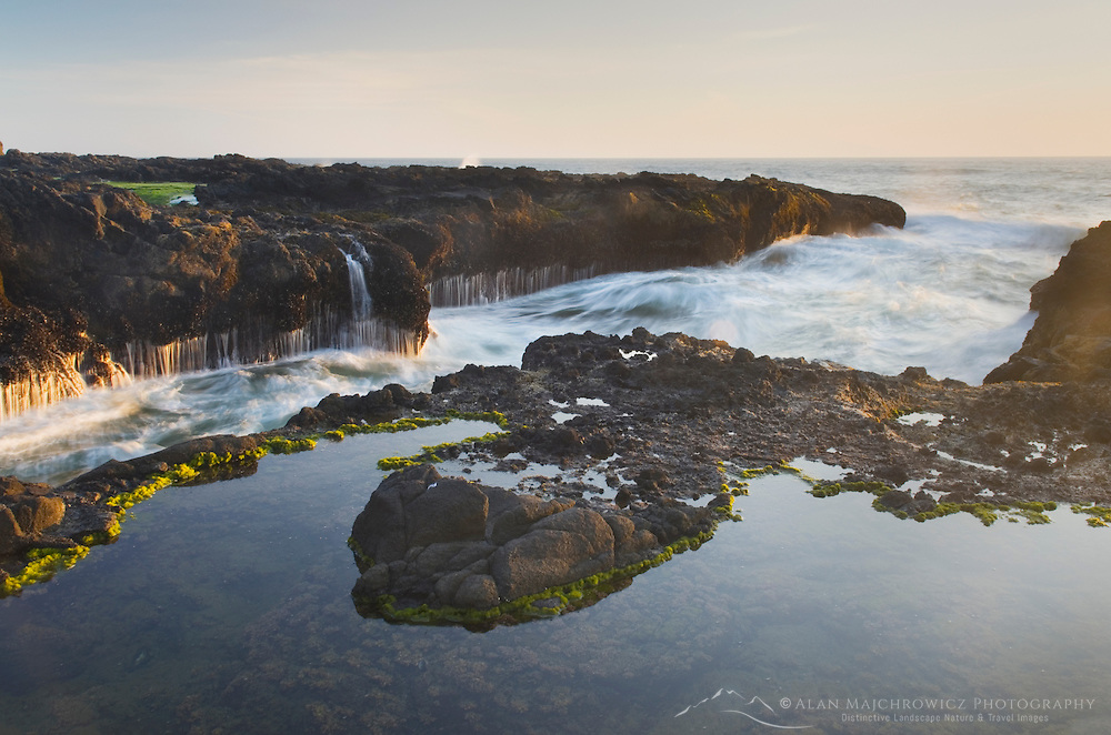 Low tide at cape Perpetua on the Oregon Coast exposes tide pools and the rugged volcanic rock shelf
