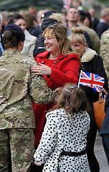 © Licensed to London News Pictures. 4 October 2013. Didcot Oxfordshire. Proud mum meets daughter. Princess Anne awarded campaign medals to 11 EOD Bomb Disposal regiment today in Didcot Oxfordshire. Photo credit : MarkHemsworth/LNP