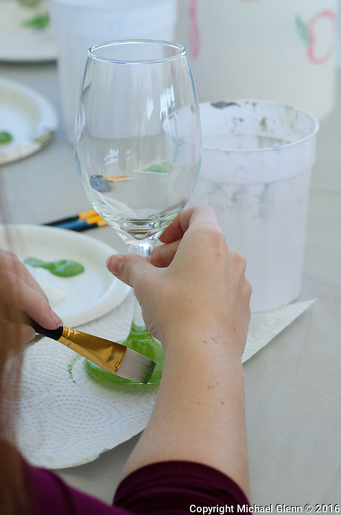 15 Oct. 2016 Forked River USA / The base of a wine glass gets some green paint at the beginning of a a wine glass painting class as St Pius X celebrates it's 10th year in their new church with a festival open to all  /  Michael Glenn  / Glenn Images