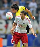 FUSSBALL   1. BUNDESLIGA   SAISON 2012/2013   LIGA TOTAL CUP  Hamburger SV - Borussia Dortmund        04.08.2012 Mats Hummels (li, Dortmund) gegen Marcus Berg (re, Hamburg)
