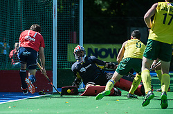 England's Alastair Brogdon passage along the backline is blocked by Australia's goalkeeper Andrew Charter. England v Australia, Bisham Abbey, Marlow, UK on 25 May 2014. Photo: Simon Parker