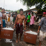 Rene and hlpers on land carry the load to the market. It is late mroning and the men are finished for the day. Joseph is 17 and works like his father did on the sea as a fisherman. The catch of the day is hauled in by the entire crew to be sorted out on deck and taken straight to the market in Hinigaran. The catch that day made the crew $12.00 each( Captain Joan $24.00) One day a week Joseph goes to Alternative Learning schooling provided by Quidan-Kaisahan.  Quidan-Kaisahan is a charity working in Negros Occidental in the Philippines. Their aim is to keep children out of work to secure them education.