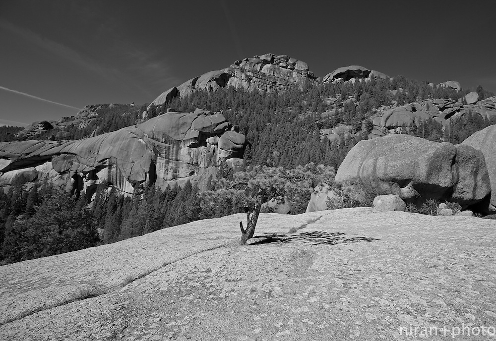 Atop a giant boulder overlooking the towering rock formations around the Lost Creek Wilderness