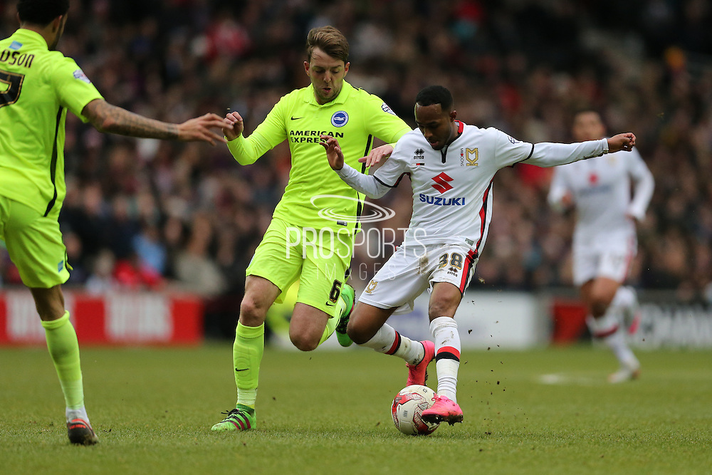 Milton Keynes Dons midfielder Rob Hall (38) and Brighton central midfielder, Dale Stephens (6) during the Sky Bet Championship match between Milton Keynes Dons and Brighton and Hove Albion at stadium:mk, Milton Keynes, England on 19 March 2016.