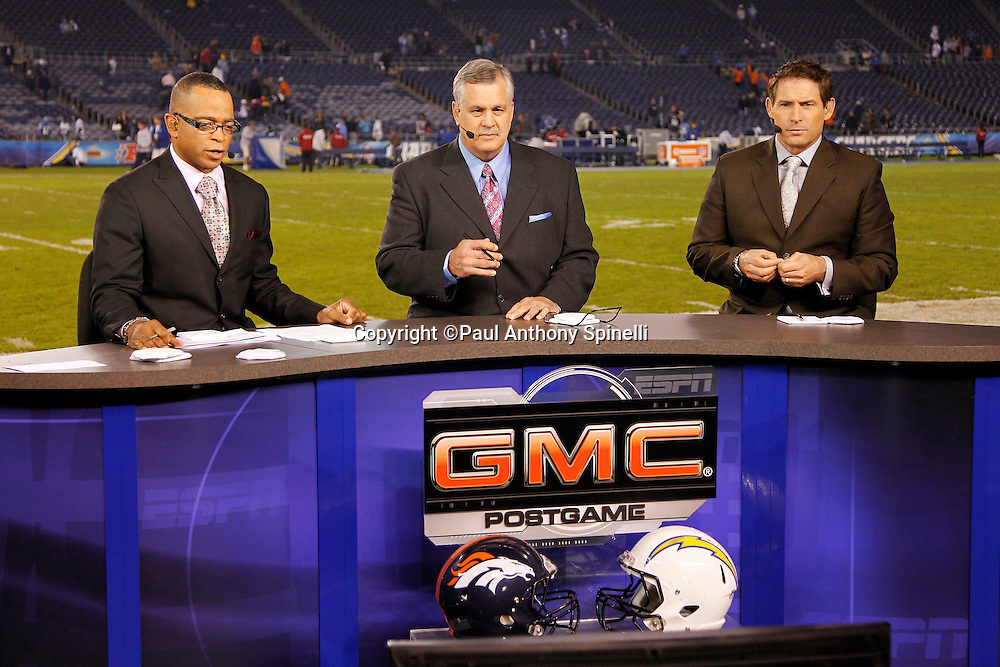 The ESPN postgame crew of (L-R) Stuart Scott, Matt Millen, and Steve Young work in the on-field set after the San Diego Chargers NFL week 11 football game against the Denver Broncos on Monday, November 22, 2010 in San Diego, California. The Chargers won the game 35-14. (©Paul Anthony Spinelli)