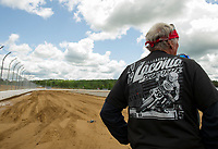 Bentley Warren looks over the new flat track he helped build behind North East Motor Sports Museum where flat track racing will return during the 2019 96th annual Laconia Motorcycle Week Rally.  (Karen Bobotas/for the Laconia Daily Sun)