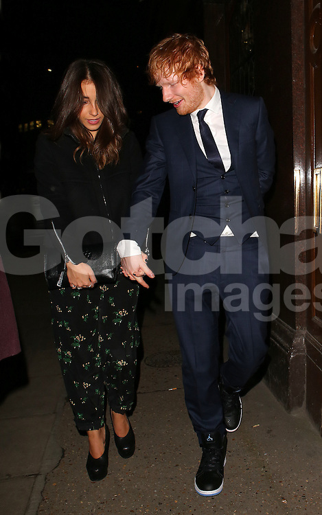 Ed Shearan and girlfriend Athina Andrelos attend the Victoria's Secret after party at The London EDITION hotel. UK. 02/12/2014<br />