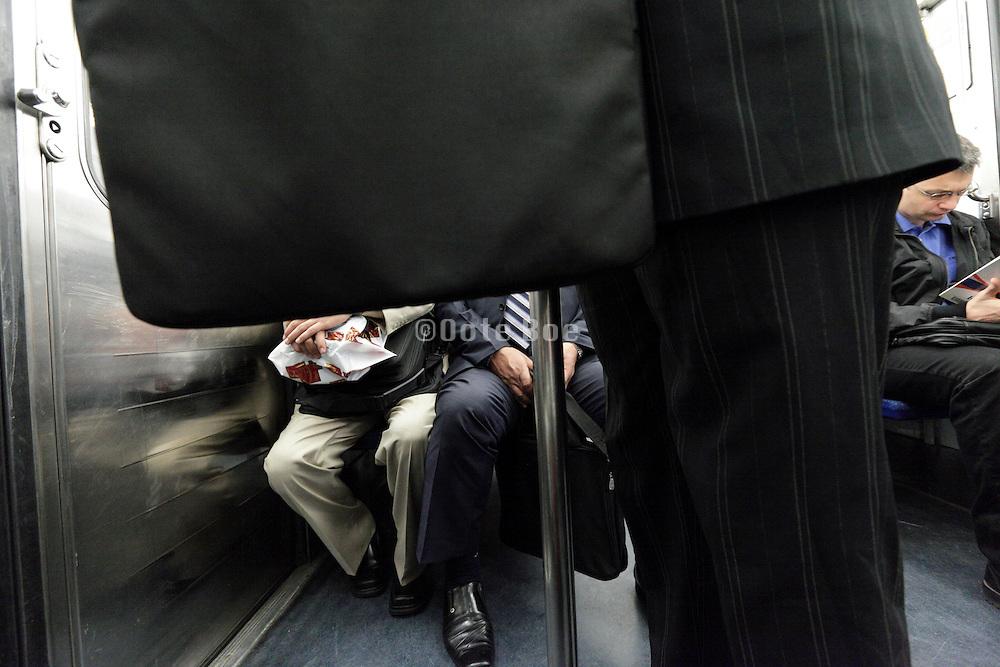 business people inside the Paris metro