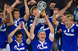 23.07.2011, Veltins arena, Gelsenkirchen, GER, Supercup, FC Schalke 04 vs. Borussia Dortmund, im Bild Benedikt Hoewedes (#4 Schalke) mit dem Pokal // during the match FC Schalke 04 vs. Borussia Dortmund at Veltins arena 2011/07/23    EXPA Pictures © 2011, PhotoCredit: EXPA/ nph/  Kurth       ****** out of GER / CRO  / BEL ******