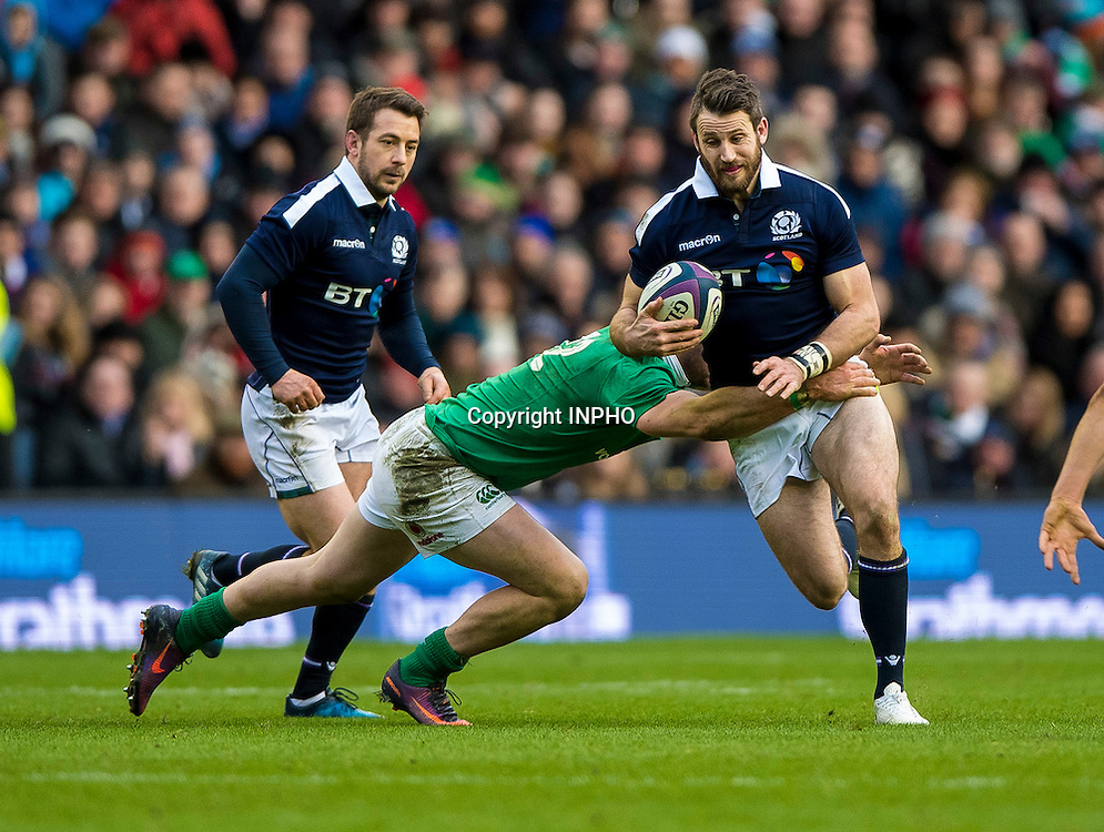 RBS 6 Nations Championship Round 1, BT Murrayfield, Scotland 4/2/2017<br /> Scotland vs Ireland<br /> Robbie Henshaw of Ireland tackles Tommy Seymour of Scotland <br /> Mandatory Credit &copy;INPHO/Craig Watson
