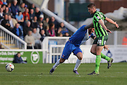 Ryan Sweeney defender for AFC Wimbledon (20) and Hartlepool United striker Billy Paynter (10) battle its out for possession during the Sky Bet League 2 match between Hartlepool United and AFC Wimbledon at Victoria Park, Hartlepool, England on 25 March 2016. Photo by Stuart Butcher.