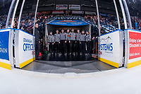 KELOWNA, CANADA - FEBRUARY 17: Referees Reagan Vetter and Bryan Bourdon along with linesmen Cody Wanner and Dustin Minty pose with young BC Hockey officials at the Kelowna Rockets against the Edmonton Oil Kings  on February 17, 2018 at Prospera Place in Kelowna, British Columbia, Canada.  (Photo by Marissa Baecker/Shoot the Breeze)  *** Local Caption ***