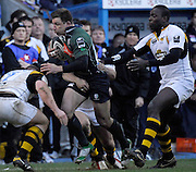 Reading, GREAT BRITAIN,  Justin BISHOP, attacking with the ball,  finds his attacking run barred by Joe WARD [left] set for contact, and Simon AMOR hanging on from behind,  right Ayoola ERINLE also running in to add his weight to the challenge, during the Guinness Premieship match, London Irish vs London Wasps  at the Madejski Stadium, England, on Sun 18.03.2007  [Photo, Peter Spurrier/Intersport-images].....