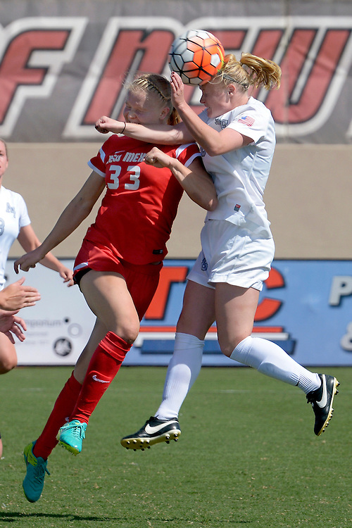 gbs092516q/SPORTS -- UNM's Jessie Hix, 33, and Air Force's Kaitlyn Ennis, right go up for a header during the game at the UNM Soccer Complex on Sunday, September 25, 2016. Air Force won 2-1.(Greg Sorber/Albuquerque Journal)