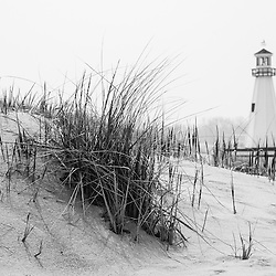 Photo of New Buffalo Michigan lighthouse and beach grass. New Buffalo is a popular beach community in Southwest Michigan in the United States.