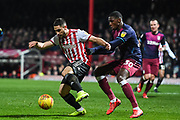 Brentford Forward Neal Maupay (9) and Aston Villa Defender Kortney Hause (30) in action during the EFL Sky Bet Championship match between Brentford and Aston Villa at Griffin Park, London, England on 13 February 2019.