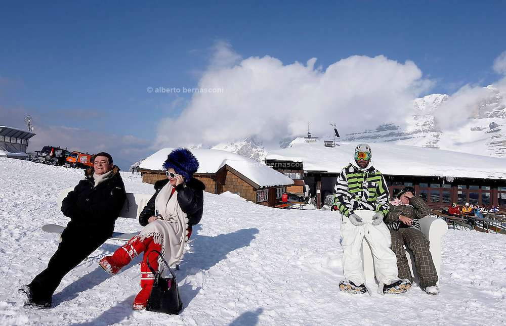 Italy, Madonna di Campiglio. lounging outside Chalet Fiat