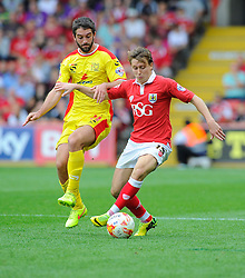 Bristol City's Luke Freeman battles for the ball with Milton Keynes Dons' Will Grigg  - Photo mandatory by-line: Joe Meredith/JMP - Mobile: 07966 386802 - 27/09/2014 - SPORT - Football - Bristol - Ashton Gate - Bristol City v MK Dons - Sky Bet League One