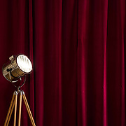 Retro studio light with a red velvet curtain background