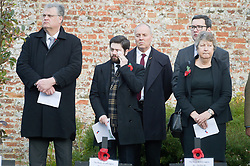 People react during a service in the Royal Wootton Bassett Field of Remembrance at Lydiard park, Swindon, as it opens to honour and remember those who have been lost serving in the Armed Forces.