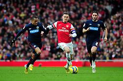 Arsenal's Thomas Vermaelen breaks free from Blackburn Rovers' Bradley Orr and Blackburn Rovers' Martin Olsson - Photo mandatory by-line: Dougie Allward/JMP - Tel: Mobile: 07966 386802 16/02/2013 - SPORT - FOOTBALL - Emirates Stadium - London -  Arsenal V Blackburn Rovers - FA Cup - Fifth Round