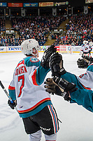 KELOWNA, CANADA - FEBRUARY 18: Lucas Johansen #7 of the Kelowna Rockets skates past the bench celebrating a goal against the Prince George Cougars on February 18, 2017 at Prospera Place in Kelowna, British Columbia, Canada.  (Photo by Marissa Baecker/Shoot the Breeze)  *** Local Caption ***